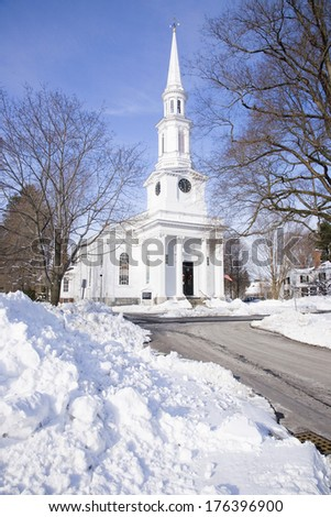 Unitarian Universalist Church surrounded by snow in Lexington, Ma., New England, USA - stock photo