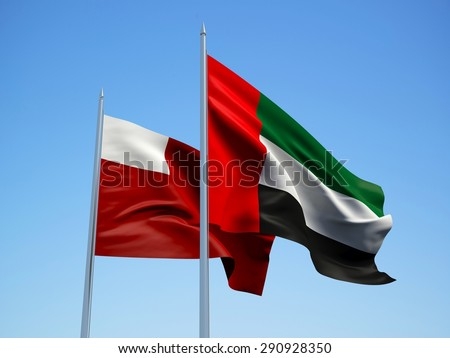 United Arab Emirates and Abu Dhabi flags waving in the wind with a blue sky background. 3d illustration - stock photo