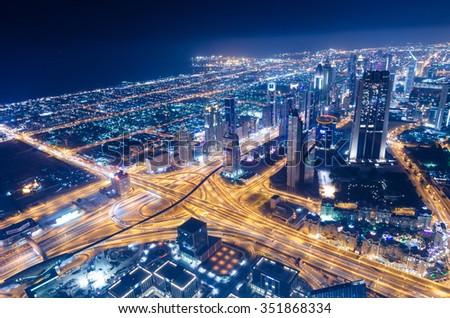 United Arab Emirates, Dubai, 07/14/2014, downtown dubai futuristic city neon lights and sheik zayed road shot from the worlds tallest tower burj khalifa - stock photo