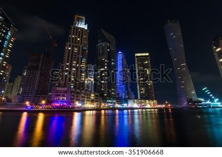 United Arab Emirates, Dubai, 04/18/2015, dubai marina city lights lit up at night with famous landmark buildings - stock photo
