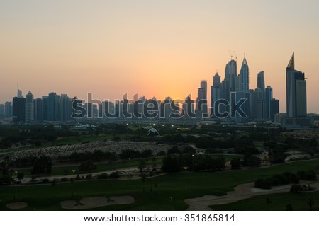United Arab Emirates, Dubai, 07/14/2014, dubai marina dusty sunset cityscape silhouette  at sunset