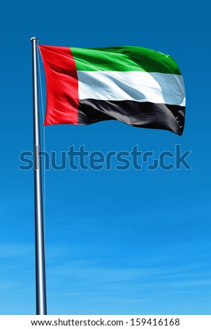 United Arab Emirates flag waving on the wind - stock photo