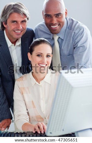 United business people working at a computer in the office - stock photo