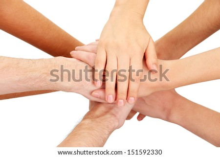 United hands isolated on white Conceptual photo of teamwork - stock photo
