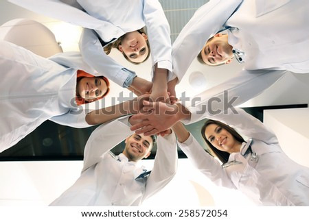United hands of medical team close up