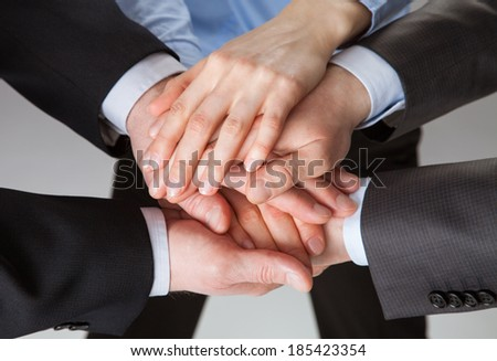 United hands of successful business team - stock photo