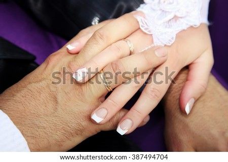 United hands of the bride and groom