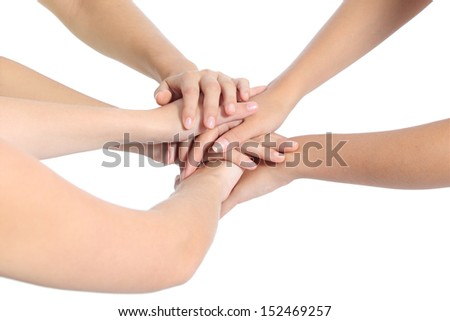 United hands of three women isolated on a white background