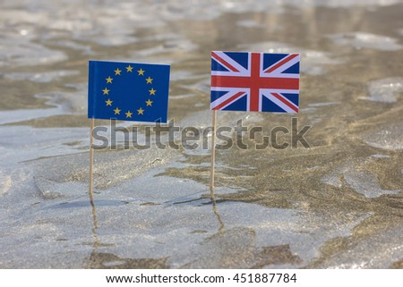 United Kingdom and European Union close up flags on the beach. Brexit Concept - stock photo