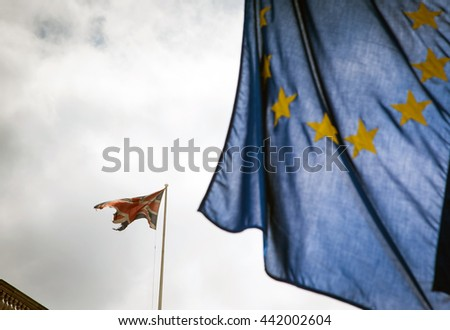 United Kingdom and European union flags combined - Focus on union jack flag as the UK votes for brexit - stock photo