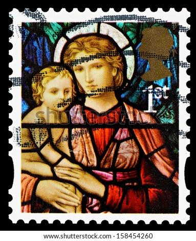 UNITED KINGDOM - CIRCA 2009: A British Used Christmas Postage Stamp showing Madonna and Child Stained Glass Window, circa 2009