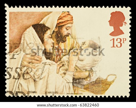 UNITED KINGDOM - CIRCA 1984: A British Used Christmas Postage Stamp showing Mary, Joseph and Jesus, circa 1984