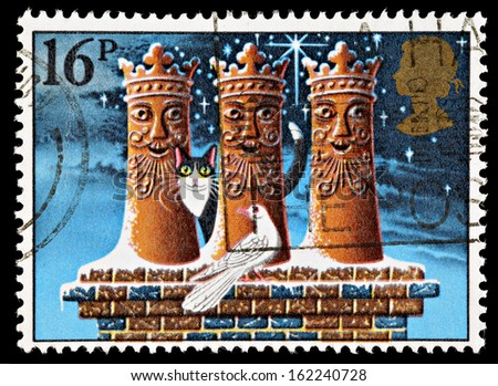 UNITED KINGDOM - CIRCA 1983: A British Used Christmas Postage Stamp showing the Three Kings as Chimney Pots, circa 1983