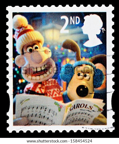 UNITED KINGDOM - CIRCA 2010: A British Used Christmas Postage Stamp showing Wallace and Gromit Carol Singing, circa 2010  - stock photo
