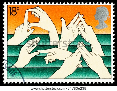 UNITED KINGDOM - CIRCA 1981: A British Used Postage Stamp Commemorating The Year of the Disabled Showing Sign Language - stock photo