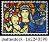 UNITED KINGDOM - CIRCA 1992: A British Used Postage Stamp showing Madonna and Child Stained Glass Window, circa 1992  - stock photo