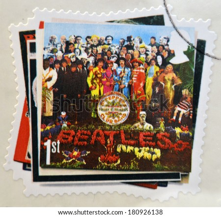 UNITED KINGDOM - CIRCA 2007: a postage stamp printed in Great Britain showing an image of The Beatles, Sgt. Peppers Lonely Hearts Club Band album cover, circa 2007.  - stock photo