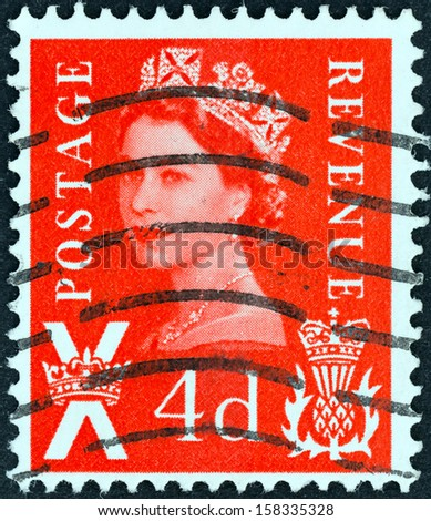 UNITED KINGDOM - CIRCA 1958: A postage stamp printed in Scotland shows Queen Elizabeth II, circa 1958.  - stock photo