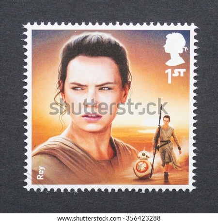 UNITED KINGDOM - CIRCA 2015: a postage stamp printed in United Kingdom commemorative of Star Wars movie with Rey character, circa 2015.  - stock photo