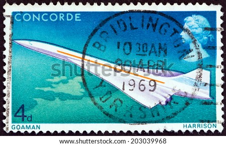 UNITED KINGDOM - CIRCA 1969: A postage stamp printed in United Kingdom issued for the 1st Flight of Concorde shows Concorde in Flight, circa 1969.  - stock photo