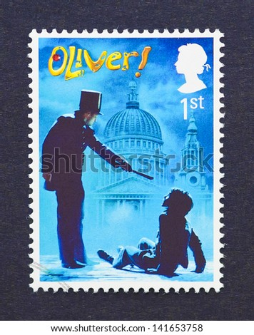 UNITED KINGDOM - CIRCA 2011: a postage stamp printed in United Kingdom showing an image of Oliver musical, circa 2011. - stock photo