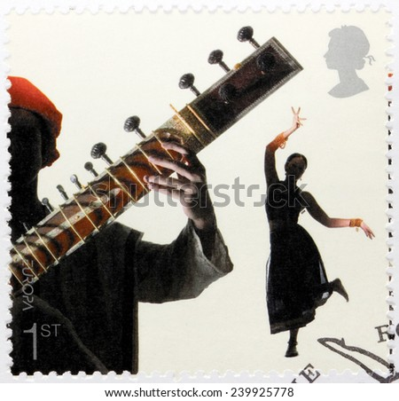 UNITED KINGDOM - CIRCA 2006: A stamp printed by GREAT BRITAIN shows Bollywood dancer and sitar player, circa 2006 - stock photo