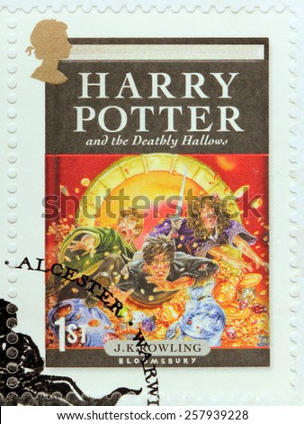 UNITED KINGDOM - CIRCA 2007: A stamp printed by GREAT BRITAIN shows image of cover of Harry Potter and the Deathly Hallows novel by Joanne (Jo) Rowling, pen names J. K. Rowling, circa 2007. - stock photo