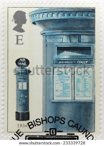UNITED KINGDOM - CIRCA 2002: A stamp printed by GREAT BRITAIN shows the British airmail box with dual notice plates, a feature introduced in 1932, circa 2002 - stock photo