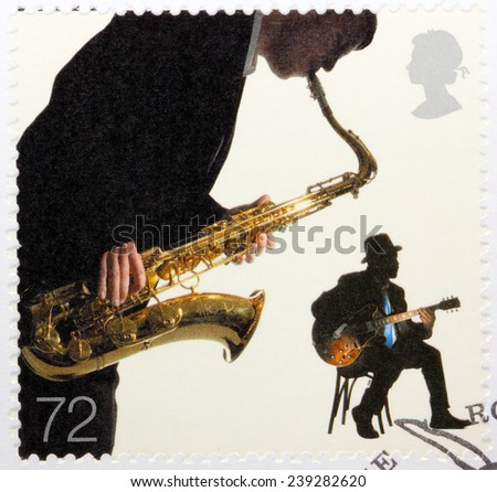 UNITED KINGDOM - CIRCA 2006: A stamp printed by GREAT BRITAIN shows two Jazz musicians - Sax Player and Blues Guitarist, circa 2006 - stock photo