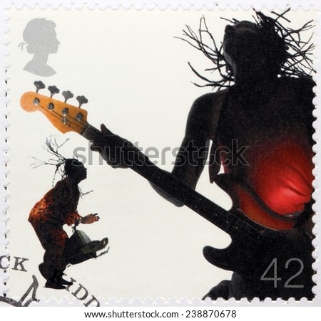 UNITED KINGDOM - CIRCA 2006: A stamp printed by GREAT BRITAIN shows two reggae musicians - bass guitar player and drummer, circa 2006 - stock photo