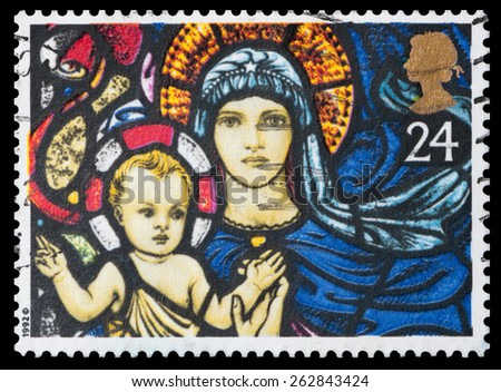 UNITED KINGDOM - CIRCA 1992: A stamp printed in England, shows the Christmas: Madonna and Child, St. Mary's Church, Bibury, circa 1992