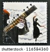 UNITED KINGDOM - CIRCA 2006: A stamp printed in Great Britain dedicated to sounds of Britain shows Bollywood and Bhangra, circa 2006 - stock photo