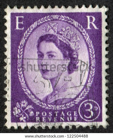 UNITED KINGDOM - CIRCA 1952: A stamp printed in Great Britain (England) shows portrait of Queen Elizabeth II, Scott Catalog 297 A127, circa 1952. - stock photo
