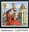 UNITED KINGDOM - CIRCA 1999: A stamp printed in Great Britain shows Bobby Moore with World Cup, circa 1999 - stock photo