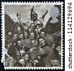 UNITED KINGDOM - CIRCA 1995: A stamp printed in Great Britain shows British Troops and French Civilians celebrating End of the Second World War, circa 1995 - stock photo