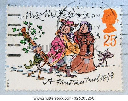 UNITED KINGDOM - CIRCA 19: A stamp printed in Great Britain shows Mr. and Mrs. Fezziwig of A Christmas Carol novel by Charles Dickens, circa 1993  - stock photo