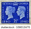 UNITED KINGDOM - CIRCA 1940: A stamp printed in Great Britain shows Queen Victoria and King George VI, circa 1940 - stock photo