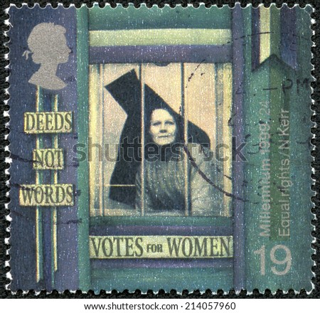 UNITED KINGDOM - CIRCA 1999: A stamp printed in Great Britain shows Suffragette behind Prison Window ('Equal Rights for Women'), circa 1999 - stock photo