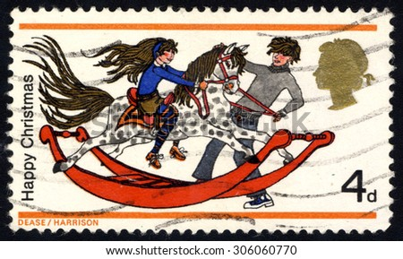 UNITED KINGDOM - CIRCA 1968: A stamp printed in the United Kingdom  from Christmas Issue, shows Boy and Girl with Rocking Horse, circa 1968 - stock photo