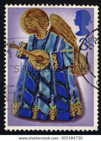 UNITED KINGDOM - CIRCA 1972: A stamp printed in the United Kingdom shows Angel with Lute, circa 1972 - stock photo