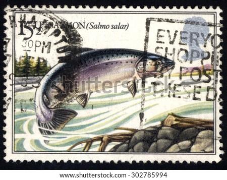 UNITED KINGDOM - CIRCA 1982: A stamp printed in the United Kingdom shows Salmon Fish, circa 1982 - stock photo