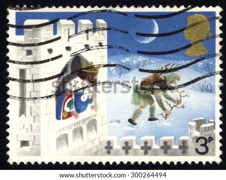 UNITED KINGDOM - CIRCA 1973: A stamp printed in the United Kingdom shows The Good king Wenceslas, the Page and Peasant, circa 1973  - stock photo