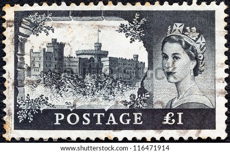 "UNITED KINGDOM - CIRCA 1955: A stamp printed in United Kingdom from the ""Castles"" issue shows Windsor castle and queen Elizabeth II, circa 1955. - stock photo"