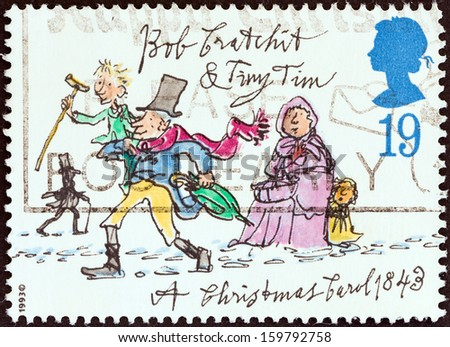"""UNITED KINGDOM - CIRCA 1993: A stamp printed in United Kingdom from the """"Christmas. 150th anniversary of A Christmas Carol novel by Charles Dickens"""" issue shows Bob Cratchit and Tiny Tim, circa 1993.  - stock photo"""