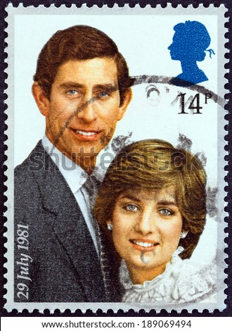 """UNITED KINGDOM - CIRCA 1981: A stamp printed in United Kingdom from the """"Royal Wedding """" issue shows Prince Charles and Lady Diana Spencer, circa 1981. - stock photo"""