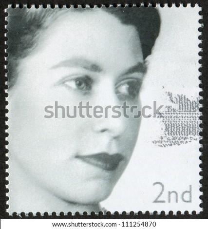 UNITED KINGDOM - CIRCA 2002: A stamp printed in United Kingdom (Great Britain, England) shows portrait of young Queen Elizabeth II, circa 2002. - stock photo