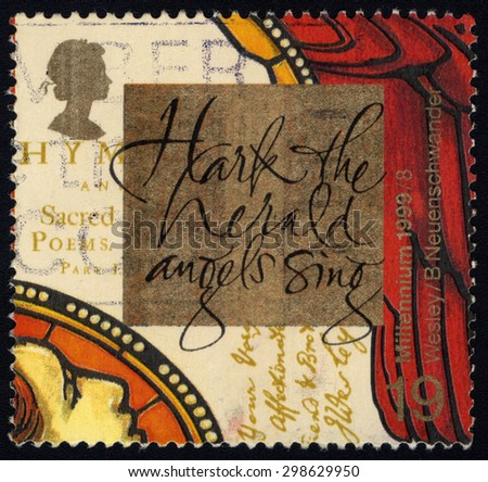 UNITED KINGDOM - CIRCA 1999: A stamp printed in United Kingdom is dedicated to John Wesley, founder of Methodism, and �Hark, The Herald Angels Sing� hymn by brother Charles, circa 1999 - stock photo