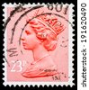 UNITED KINGDOM - CIRCA 1977: A stamp  printed in United Kingdom showing Portrait of Queen Elizabeth II in light red, circa 1977.  - stock photo