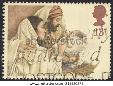 UNITED KINGDOM - CIRCA 1984: A stamp printed in United Kingdom shows a Christmas postage stamp with Mary, Joseph and Baby Jesus, circa 1984 - stock photo