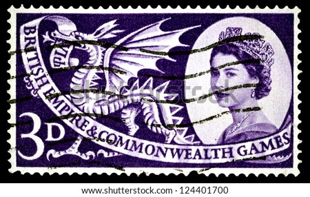 "UNITED KINGDOM - CIRCA 1958: A stamp printed in United Kingdom shows portrait of Elizabeth II and Welsh dragon, with inscriptions and name of series ""British Empire and Commonwealth Games"", circa 1958"